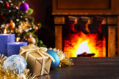 Christmas scene with fireplace and Christmas tree in the backgro Royalty Free Stock Images