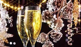 Christmas scene. Flutes with sparkling champagne Stock Photos