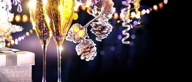Christmas scene. Flutes with sparkling champagne Royalty Free Stock Photos