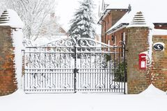Christmas scene house gates in snow royalty free stock image