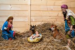 Nativity scene in the stable. Christmas scene manger with figures including Jesus Maria Giuseppe ox and donkey Royalty Free Stock Photography