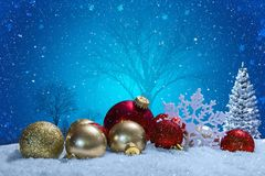 Christmas scene with ornaments and snow. And a blue background. Christmas concept photography Stock Photos