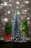 Christmas scene with silver and green trees and dark tray-brown background Stock Photo