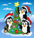 Christmas scene with three penguins Royalty Free Stock Photography