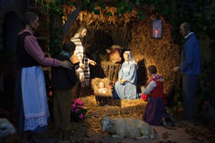 Christmas scene with three Wise Men and baby Jesus. Christmas nativity scene with three Wise Men presenting gifts to baby Jesus, Mary & Joseph stock photography