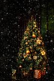 Christmas scene with tree gifts and fire in background stock image
