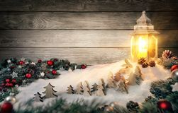 Christmas scene in warm candle light of a lantern stock photos