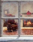 Christmas scene through window Royalty Free Stock Images