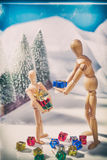 Christmas Scene with wooden mannequin Stock Image