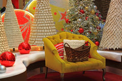 Christmas Scene. With yellow chair, pillows, basket, and decorations stock photo