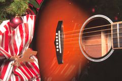 Christmas scenery, with decorations and gifts. Christmas scenery, with decorations, gifts and a wooden acoustic guitar ready to be played stock photos