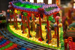 Close-up details of gingerbread Christmas scenery with human figurines dressing up the traditional vintage winter clothes standing. Christmas scenery with human stock photos