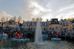 Christmas scenery at lake with Santa Claus by dusk. Christmas season in Europa Park Rust, Germany, with the funny scenery of Santa Claus figures on ice floes on Royalty Free Stock Images