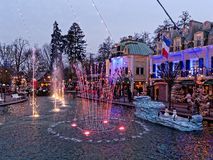 Christmas scenery at lake with waterspout fountain by dusk. Christmas spirit in Europa Park Rust, Germany, with the beautiful scenery of lighted water fountains stock image
