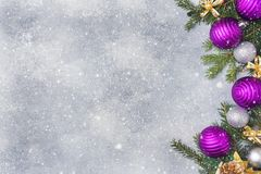 Christmas scenery, toys and branches fir on grey background. New Year concept Copy space.  stock photo