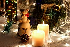 Christmas candle. Christmas scenes. Candles on the table surrounded by scattered toys Stock Photo