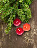 Christmas Scented Candles and Fir Tree Branches Stock Photography