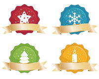 Christmas seals with gold banners. Christmas seals with gold ribbon banners isolated on white Royalty Free Stock Photo