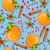Christmas seamless background with candies and oranges. Stock Photos