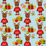 Christmas seamless background with deers. Vector pattern. Royalty Free Stock Photo
