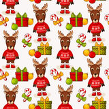Christmas seamless background with deers. Vector pattern. Royalty Free Stock Images