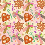 Christmas seamless background with gingerbread, candy shape of hearts and stars,  bows and pastries on decorative background Royalty Free Stock Photography