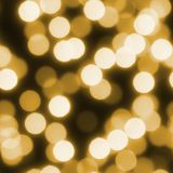 Christmas seamless background of gold bokeh lights stock photos
