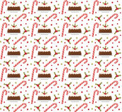 Christmas seamless background with holly, candy cane and pudding. Christmas background. Christmas seamless texture, wallpaper, fab Royalty Free Stock Photo