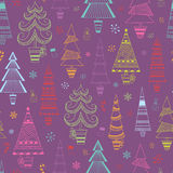 Christmas seamless background. With multicolored fir trees and snowflakes for your design Stock Image
