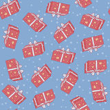 Christmas seamless background pattern of gift boxes with stars. Vector illustration Stock Images