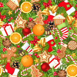Christmas seamless background. Vector illustration. Vector seamless background with fir branches, balls, bells, gingerbread cookies, candy canes, cones, socks Royalty Free Stock Photos