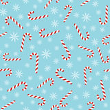 Christmas seamless blue pattern with candy canes Stock Images