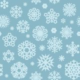 Christmas Seamless Blue Pattern with a Snowflakes Stock Image