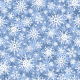Christmas seamless blue and white background with snowflakes. Vector illustration. Stock Images