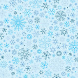 Christmas seamless doodle pattern with snowflakes Stock Image
