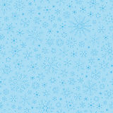 Christmas seamless doodle pattern with snowflakes Royalty Free Stock Images