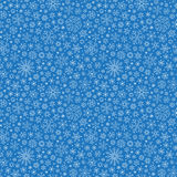 Christmas seamless doodle pattern with snowflakes Stock Photos