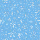 Christmas seamless doodle pattern with snowflakes Royalty Free Stock Photos