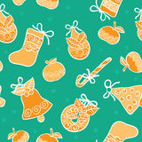 Christmas seamless green vector background. Christmas vector background with apples, bells, balls Royalty Free Illustration