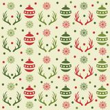 Christmas seamless pattern with balls, reindeer horns and snow royalty free illustration