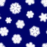 Seamless pattern of big blurry snowflakes. Christmas seamless pattern of big blurry snowflakes, white on blue background Royalty Free Stock Photos