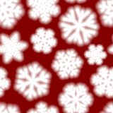 Seamless pattern of big blurry snowflakes. Christmas seamless pattern of big blurry snowflakes, white on red background Stock Images