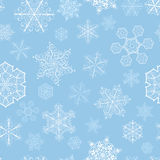 Christmas seamless pattern with big and small snowflakes Royalty Free Stock Photos