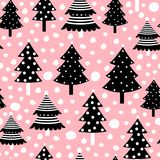 Christmas seamless pattern with black trees on pink background Stock Image