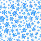Christmas seamless pattern with blue snowflakes Stock Images