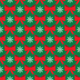 Christmas seamless pattern. With bows and snowflakes Royalty Free Stock Images