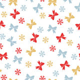 Christmas seamless pattern with bows and snowflakes Royalty Free Stock Image
