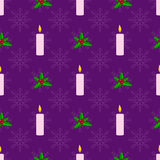 Christmas seamless pattern. With candles and holly berries Royalty Free Stock Images