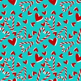 Christmas seamless pattern with candy cane and hearts . stock illustration
