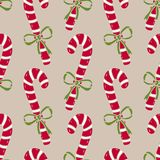 Christmas seamless pattern of candy canes. Bright wrapping paper on beige background. Stock Photography